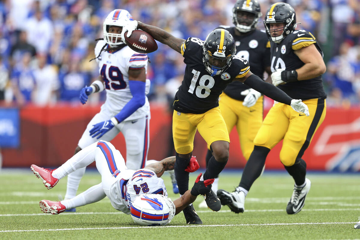 Pittsburgh Steelers wide receiver Diontae Johnson (18) is tackled by Buffalo Bills cornerback T ...