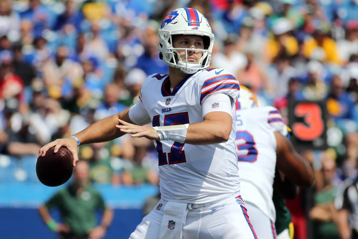 FILE - In this Saturday, Aug. 28, 2021, file photo, Buffalo Bills quarterback Josh Allen throws ...