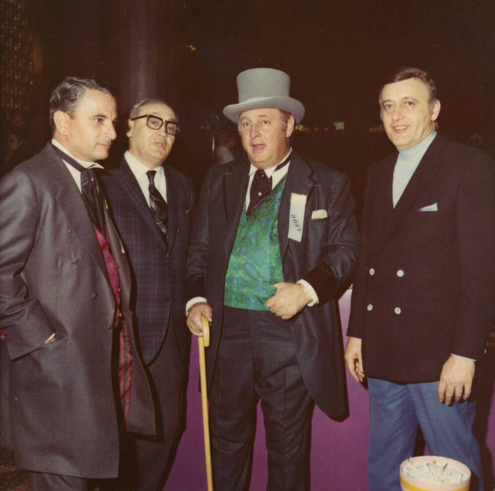 Photograph of Stan Mallin, Herman Sarno, Jay Sarno, and an unidentified man at the opening of C ...