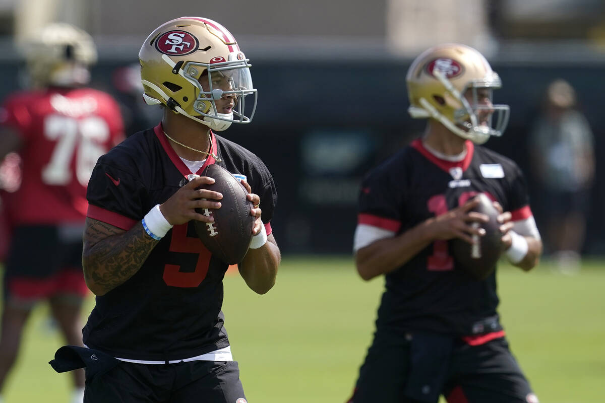 San Francisco 49ers quarterbacks Trey Lance, left, and Jimmy Garoppolo throw passes at NFL foot ...