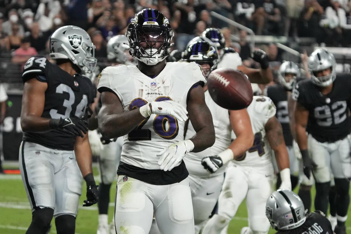 Baltimore Ravens running back Latavius Murray (28) scores a touchdown against the Las Vegas Rai ...