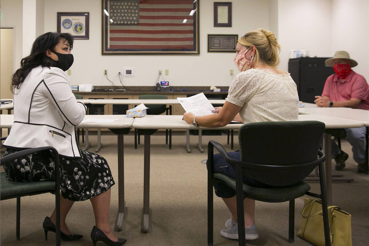 Stacey Campbell, left, chief deputy clerk at City of Las Vegas, and Molly Taylor, Expel Michele ...