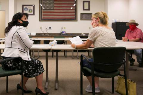 LuAnn Holmes, left, city clerk at City of Las Vegas, and Molly Taylor, Expel Michele organizer, ...