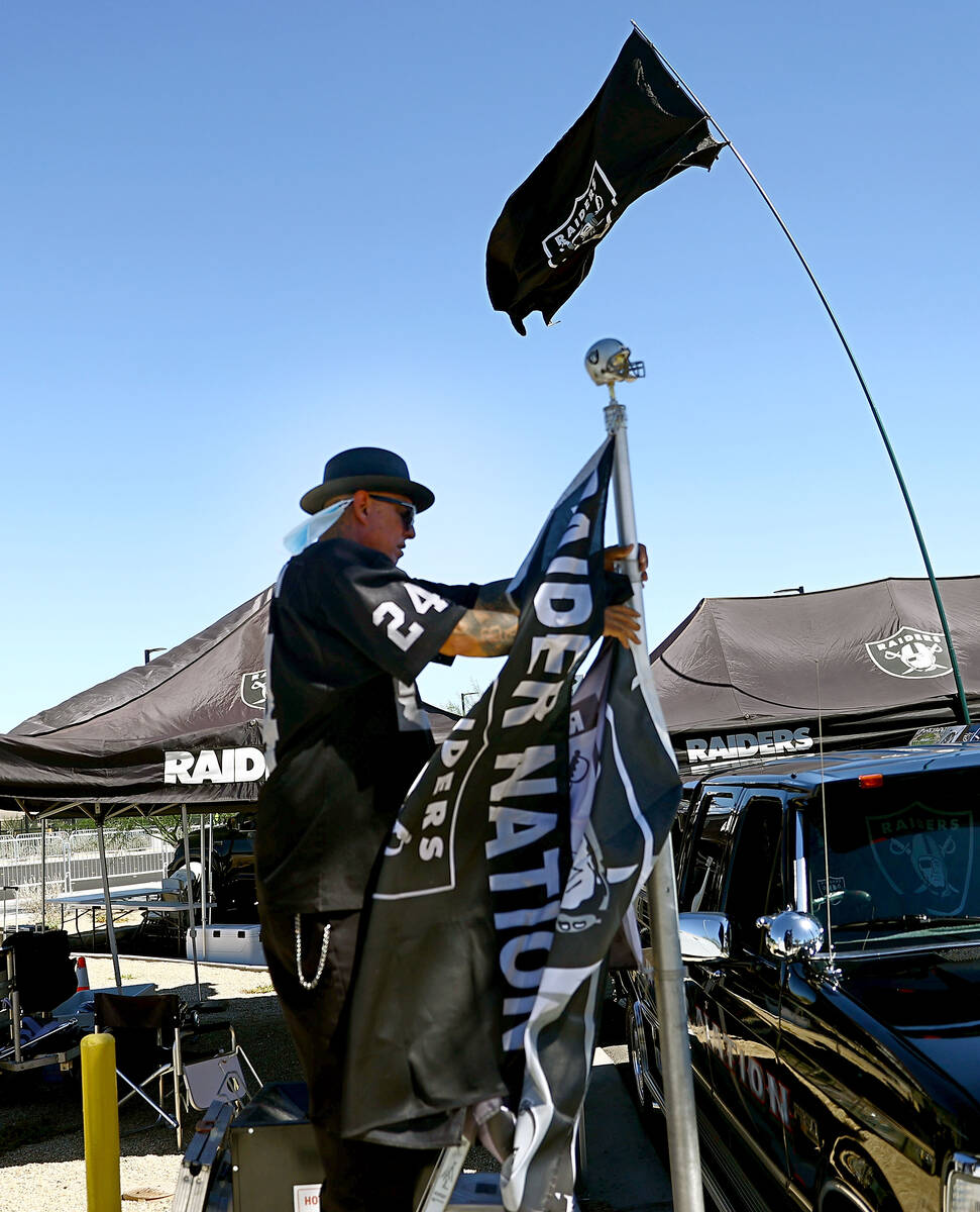 A man called himself Cadillac Ruiz of North Las Vegas prepares for tailgating before an NFL foo ...