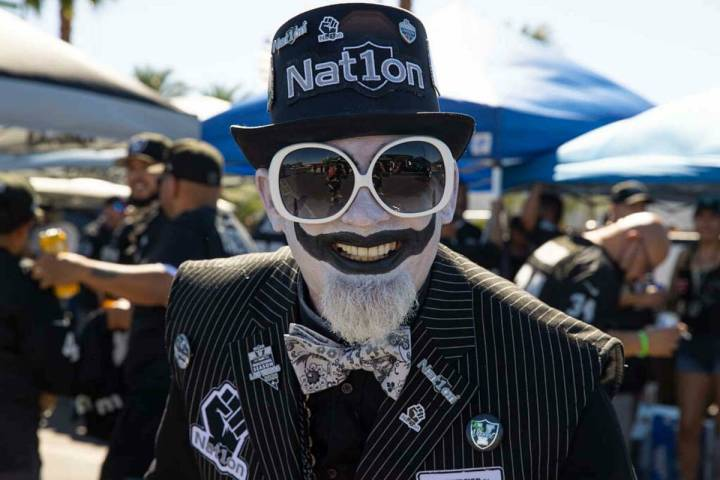 Joker Raider tailgates before an NFL football game between the Raiders and Baltimore Ravens at ...