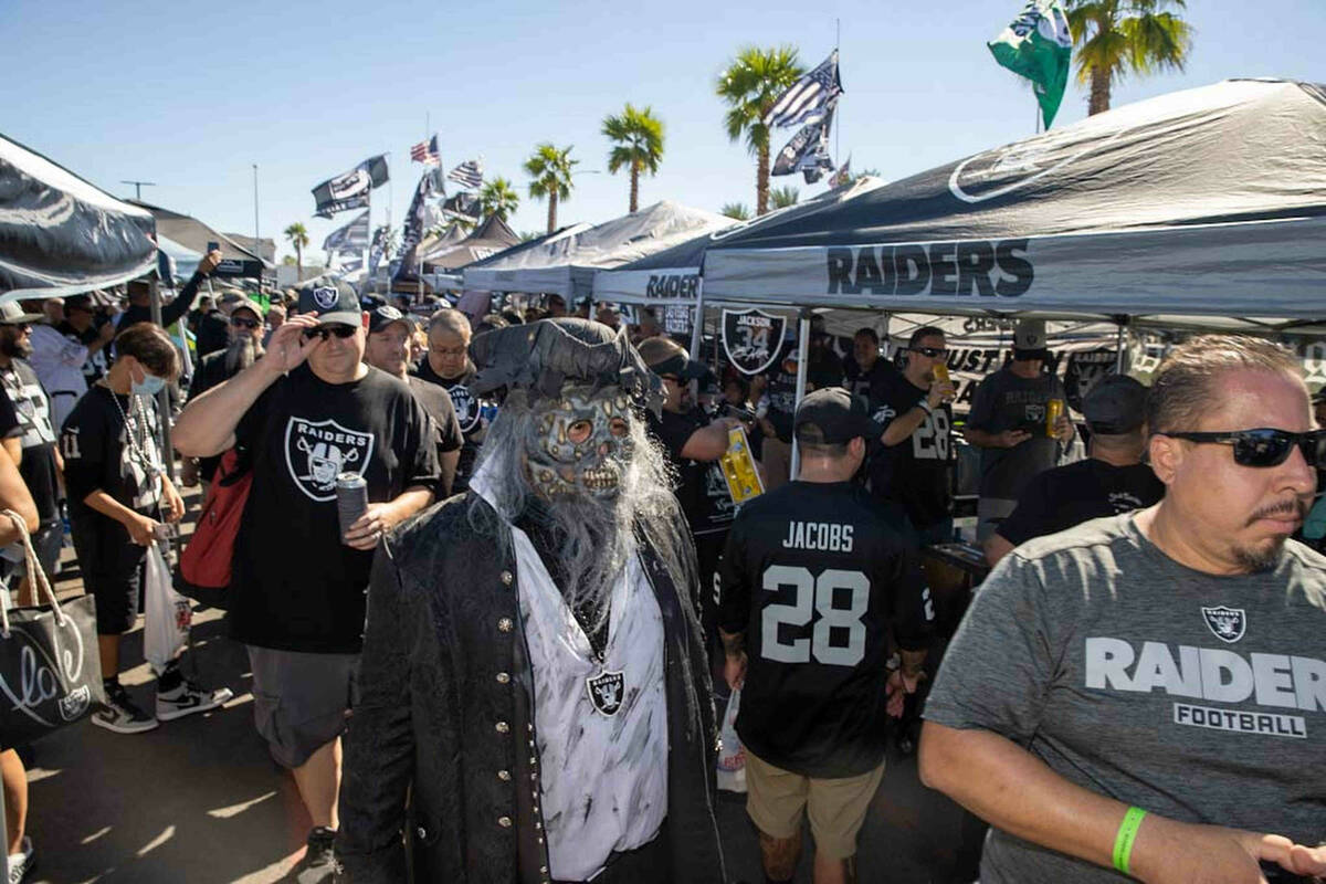 Tailgaters before an NFL football game between the Raiders and Baltimore Ravens at Allegiant St ...