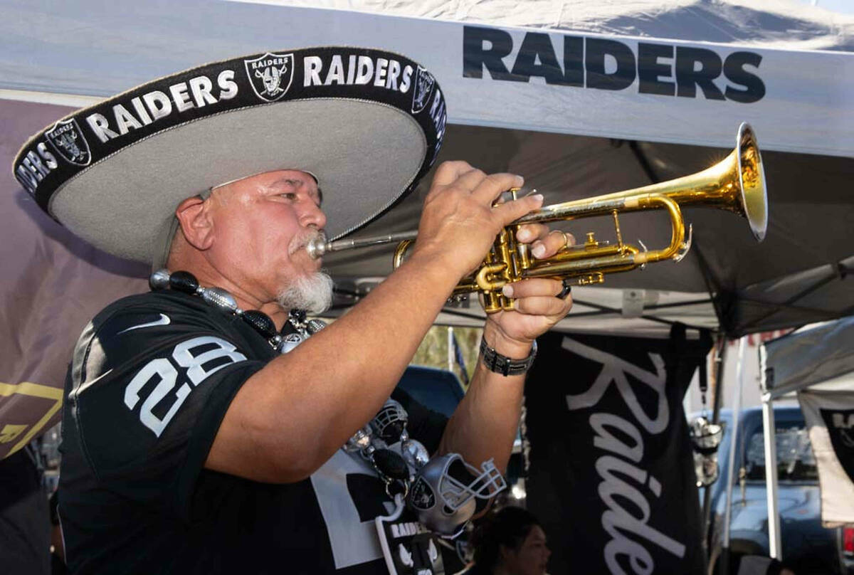 Tony Valdivia, of Stockton, CA, performs at a tailgate party before an NFL football game betwee ...