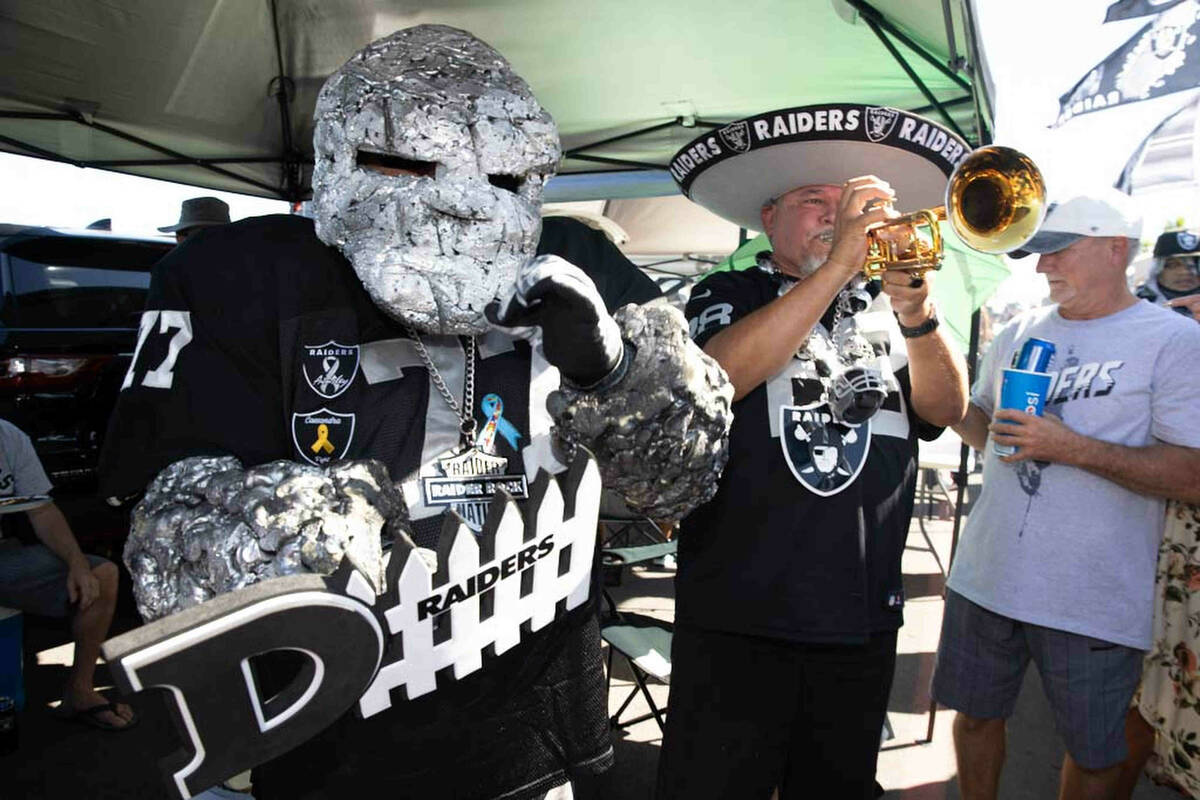 Raiders Rock, left, and Tony Valdivia tailgate before an NFL football game between the Raiders ...