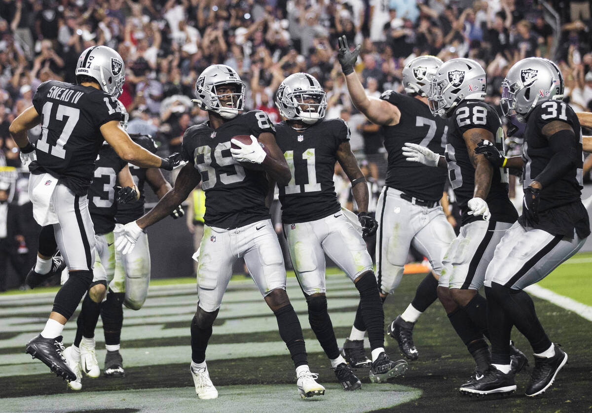 Raiders wide receiver Bryan Edwards (89) celebrates a big play with teammates in overtime durin ...