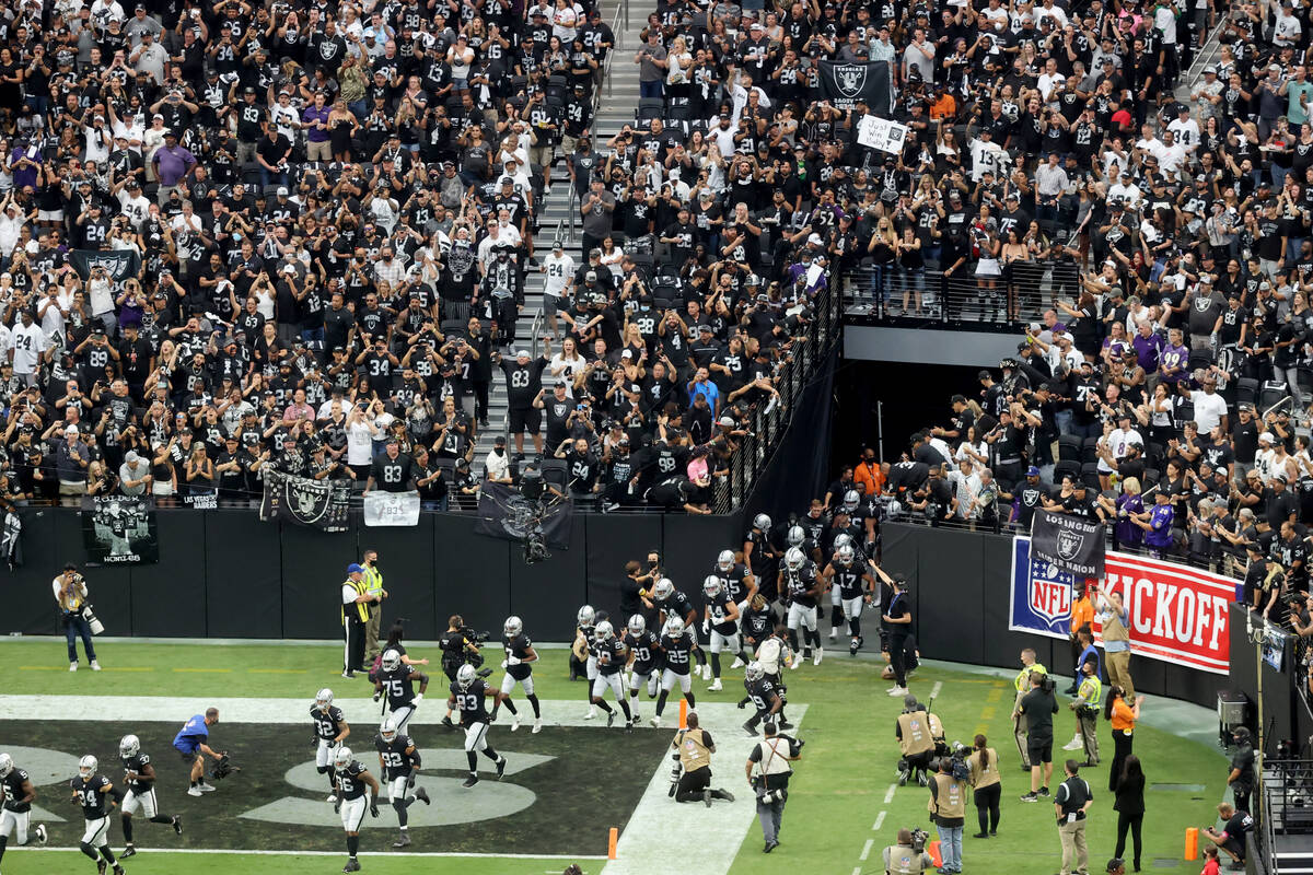 """Fans cheer as the Raiders take the field to host the Baltimore Ravens on """"Monday Night Football ..."""