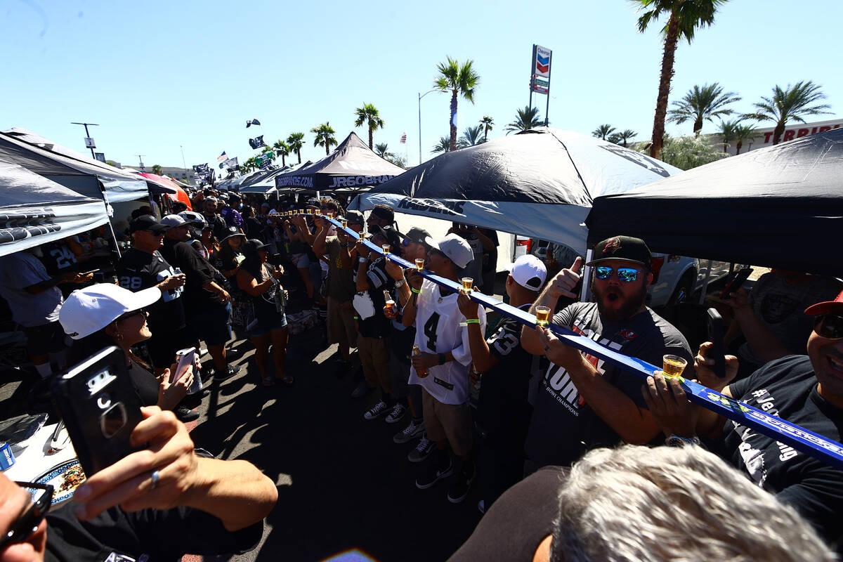 Raiders fans fire up cigars ahead of the team's game against the Baltimore Ravens on Monday, Se ...