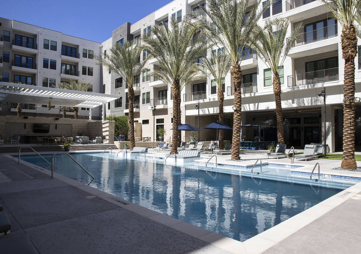 Swimming pool area at Auric Symphony Park, the first luxury multifamily residential community a ...
