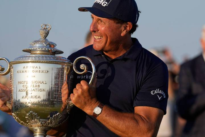 Phil Mickelson holds the Wanamaker Trophy after winning the final round at the PGA Championship ...