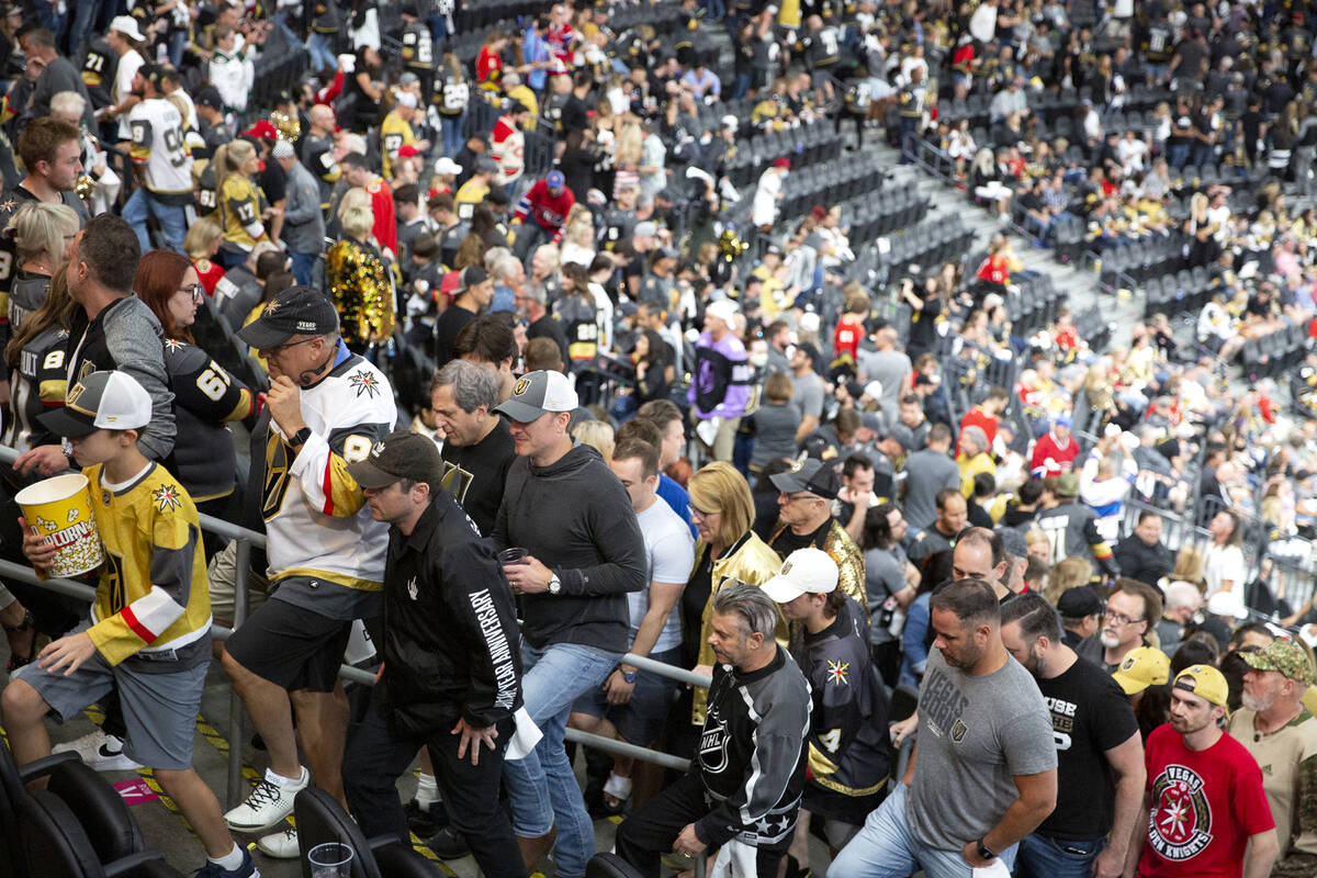 Fans leave the game before the third period is over in Game 5 of an NHL hockey Stanley Cup semi ...