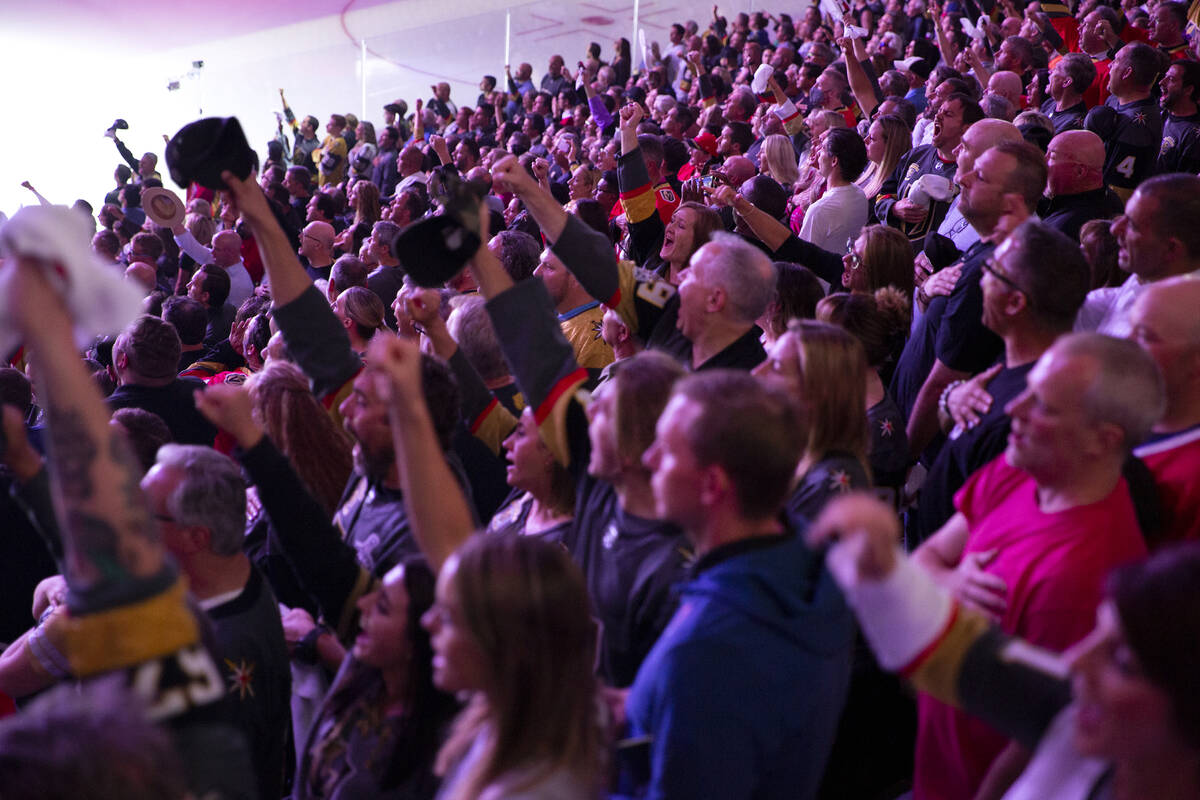Golden Knights fans shout along with the lyrics to the National Anthem when the song gets to th ...