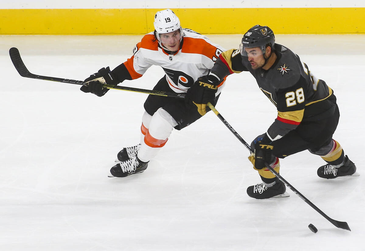 Golden Knights left wing William Carrier (28) moves the puck past Philadelphia Flyers center No ...