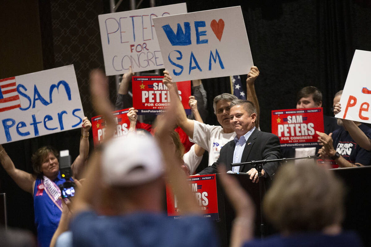 Republican Sam Peters, who is running for Nevada's 4th Congressional District, reacts as the cr ...