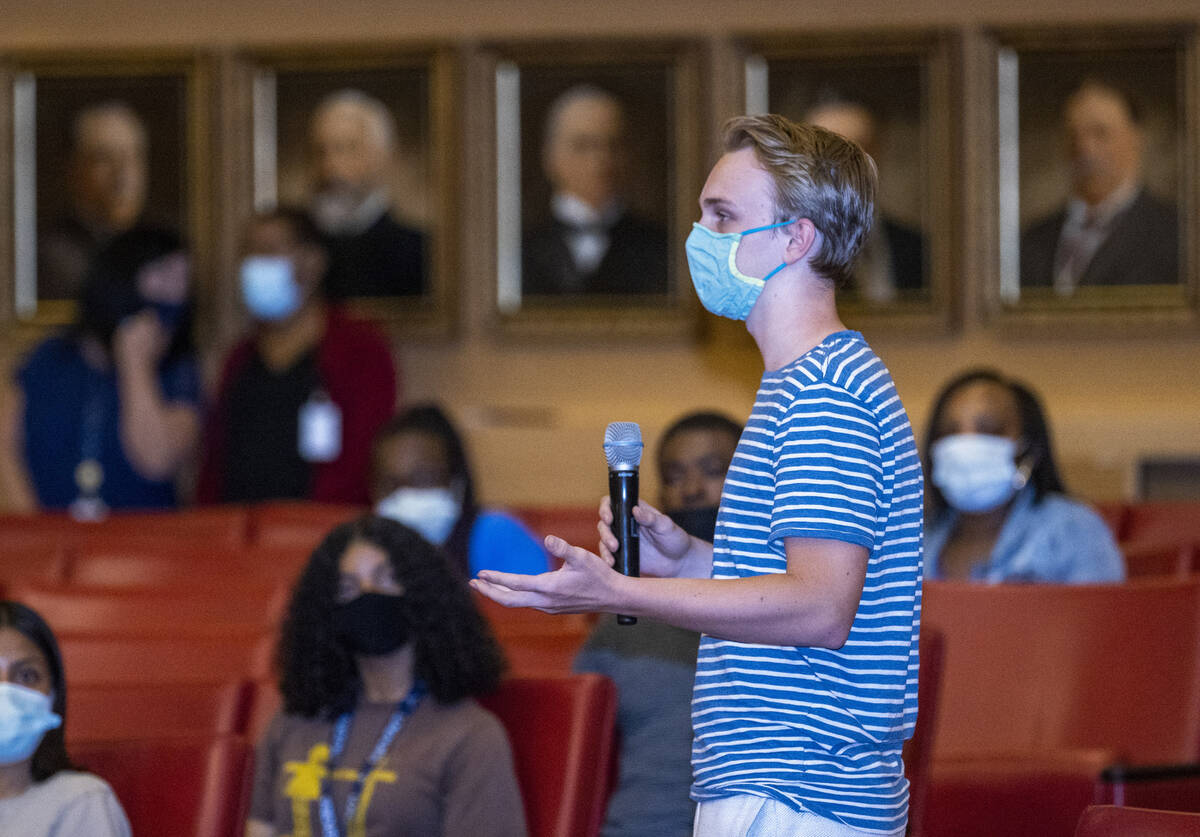A participant answers a question during a youth mental health conversation as part of the city' ...