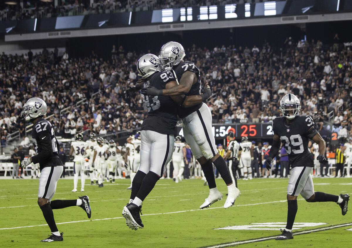 Raiders defensive end Quinton Jefferson (77) and Raiders defensive tackle Gerald McCoy (93) cel ...