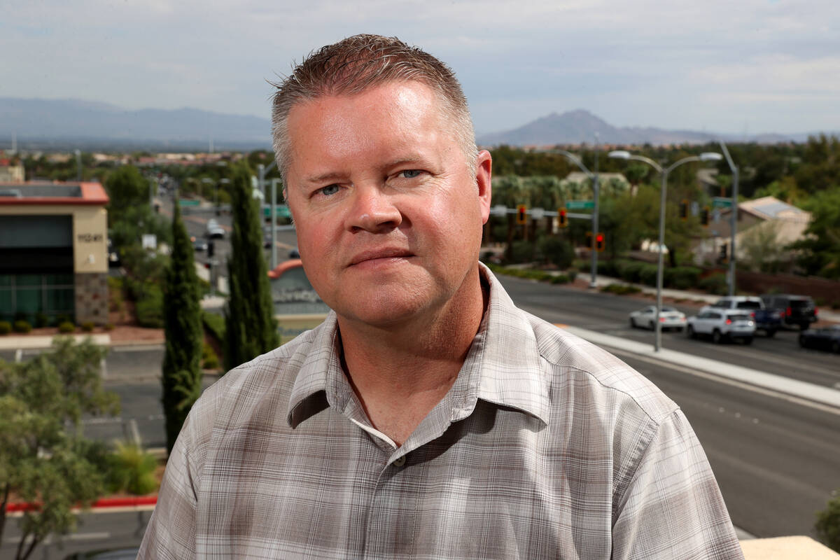 Wayne Dice, Southern Nevada liaison for the Nevada Police Union, talks to a reporter at a Hende ...