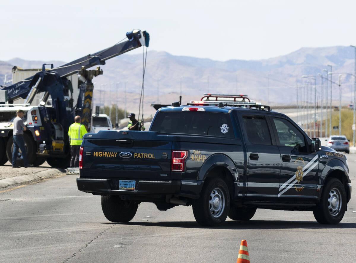 The Nevada Highway Patrol investigates a rollover crash on Blue Diamond Road and Edmond Street, ...