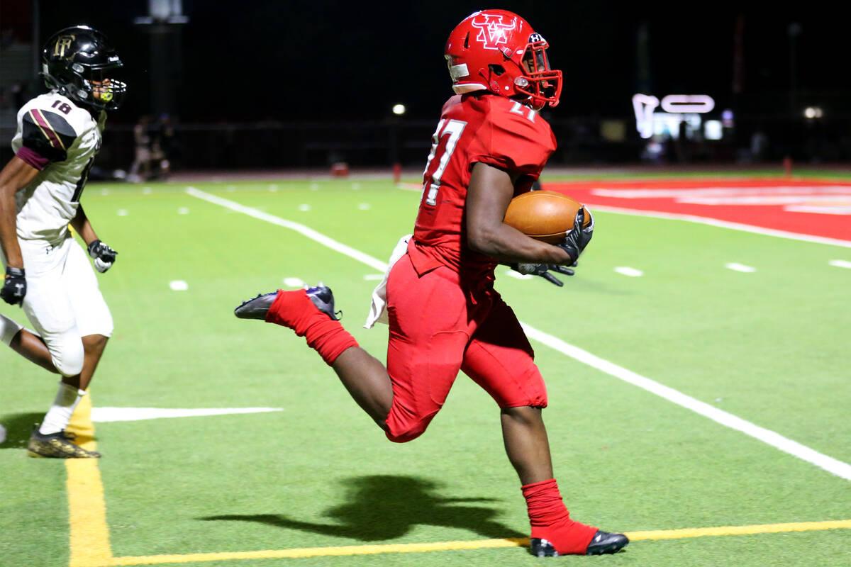 Arbor View's Makhai Donaldson(27) runs for a touchdown as Faith Lutheran's Cam'ren-chance Bro ...