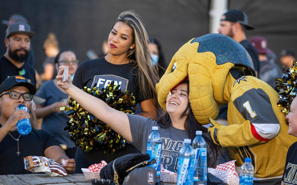 Chance the Gila monster bites the head of Amanda Lopez during the Golden Knights annual Fan Fes ...
