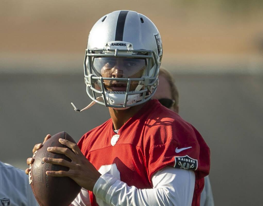 Raiders quarterback Marcus Mariota (8) prepares to throw during an NFL football practice on Tue ...
