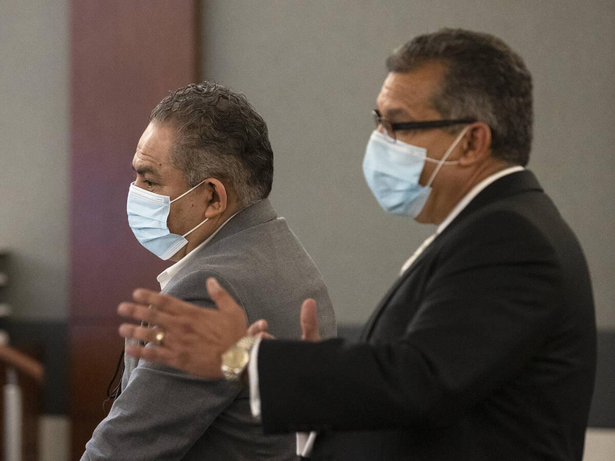 Omar Rueda-Denvers, left, listens as his attorney Christopher Oram speaks during Denvers' ret ...