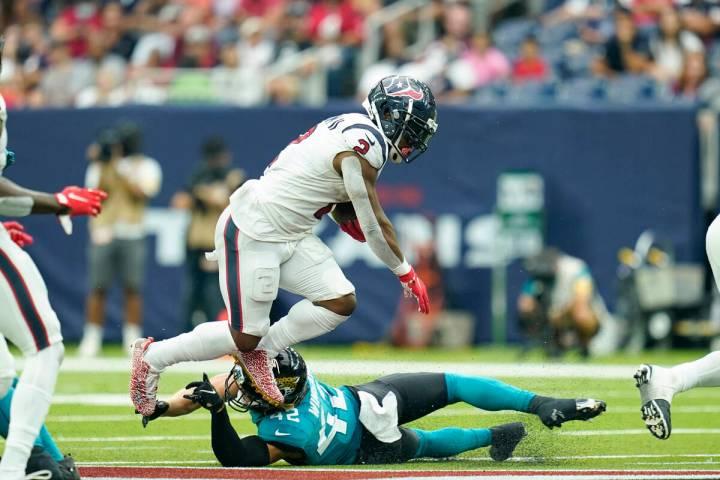 Houston Texans running back Mark Ingram II (2) carries the ball during an NFL football game aga ...