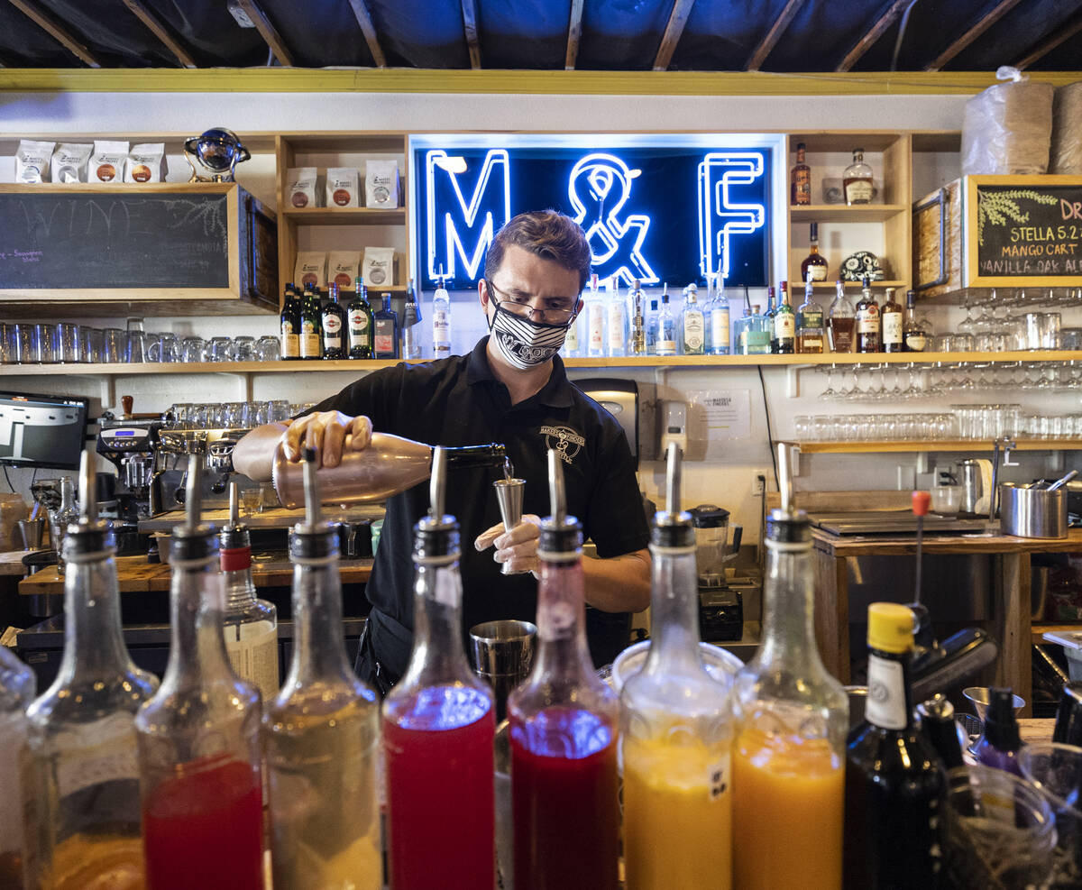 """Bar assistant Jeremy Perry makes a """"Baby Driver"""" at Makers & Finders on Wedne ..."""