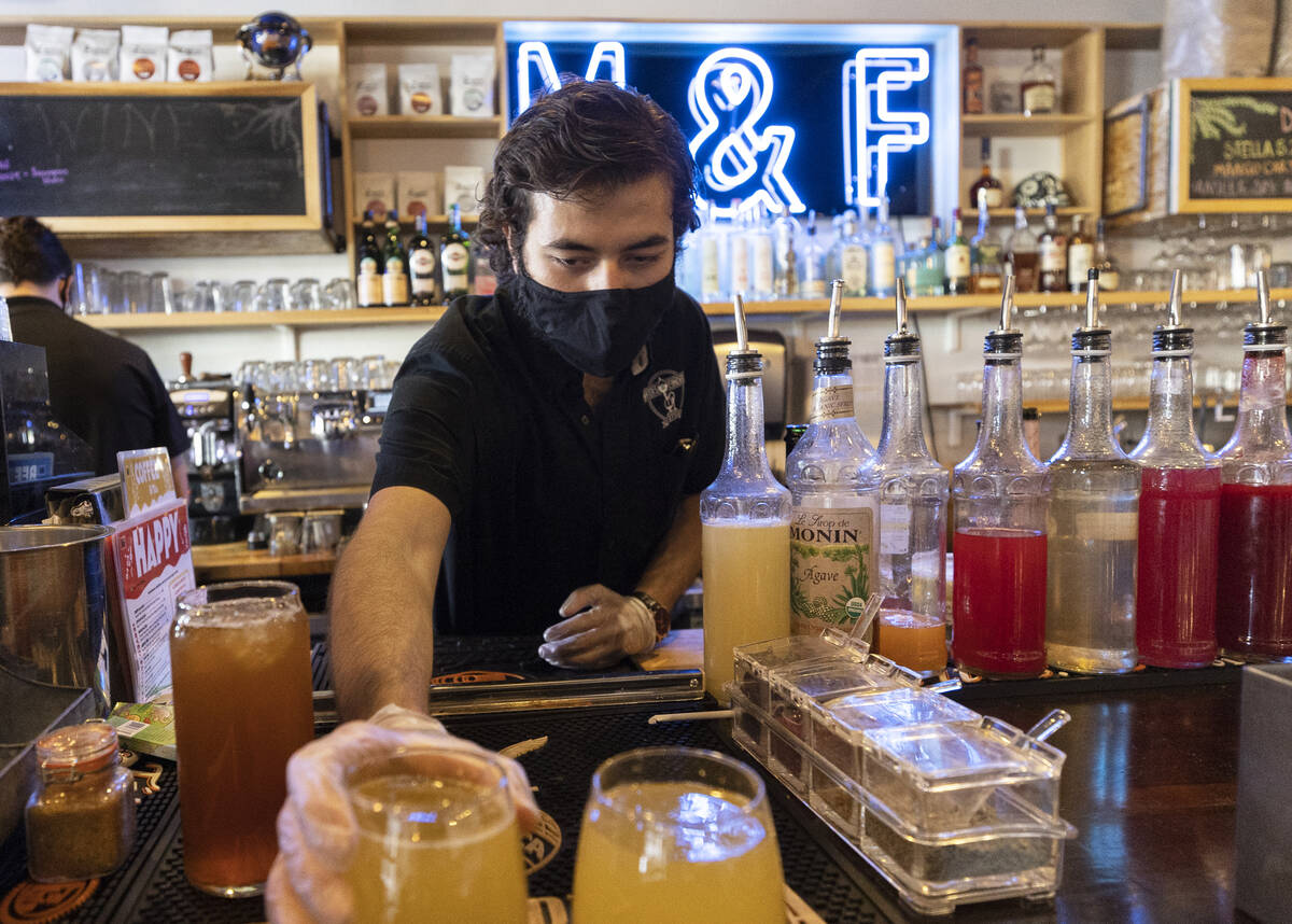 Barkeep Joseph Daniels serves drinks at Makers & Finders on Wednesday, Sept. 15, 2021, in L ...