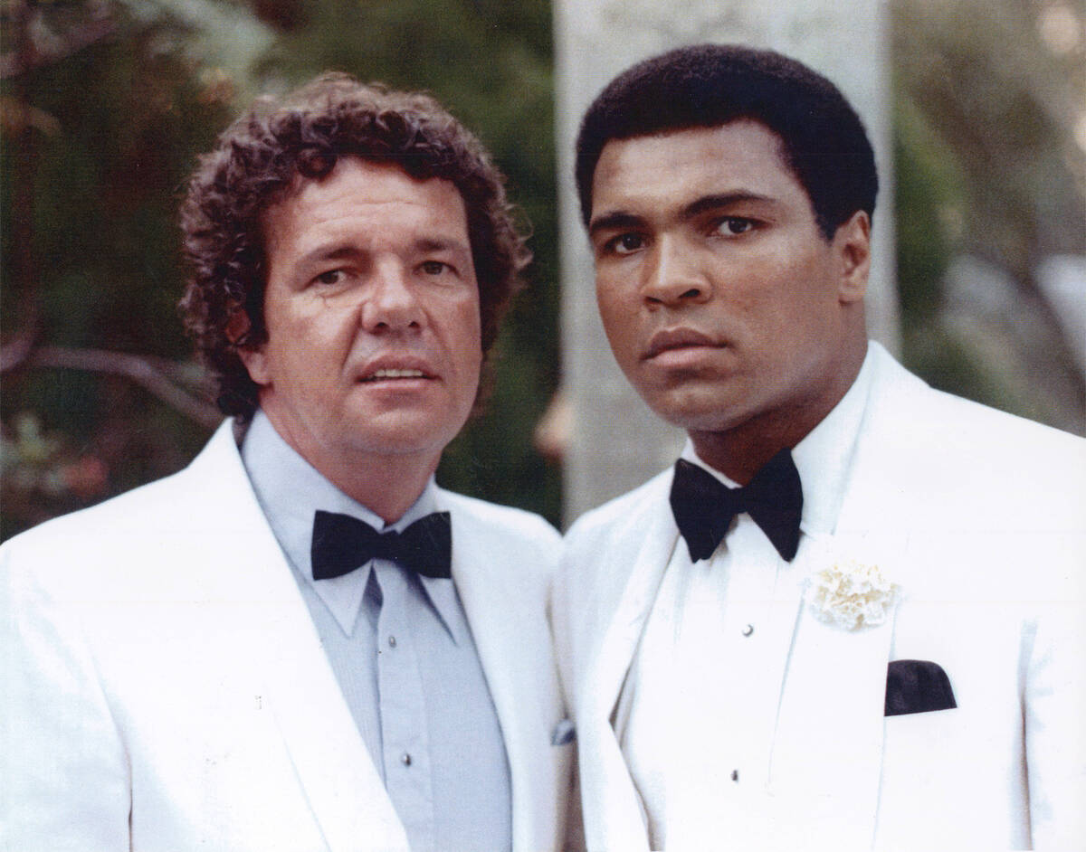 Muhammah Ali with manager and longtime friend Gene Kilroy, at a 1976 event where Ali was being ...