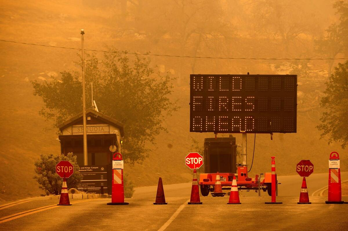 Cones block the entrance to Sequoia National Park, Calif., as the KNP Complex Fire burns nearby ...