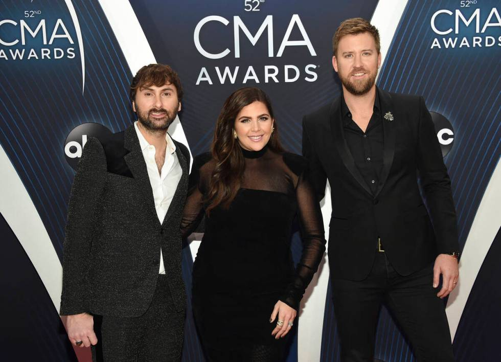 Dave Haywood, from left, Hillary Scott and Charles Kelley, of Lady A, formerly Lady Antebellum, ...