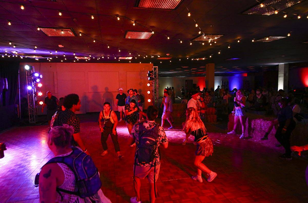 Attendees dance to music at the Western Country Club during the final day of the Life is Beauti ...