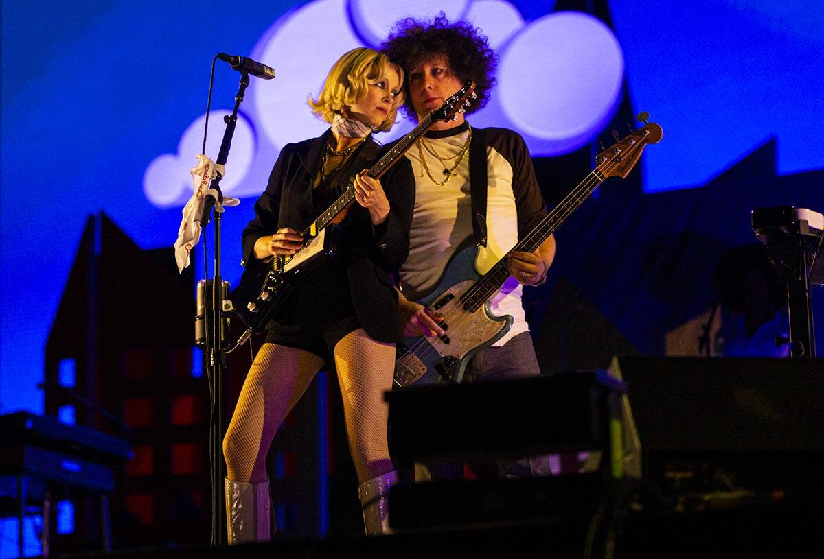 St. Vincent, left, performs with her band at the downtown stage during the final day of the Lif ...