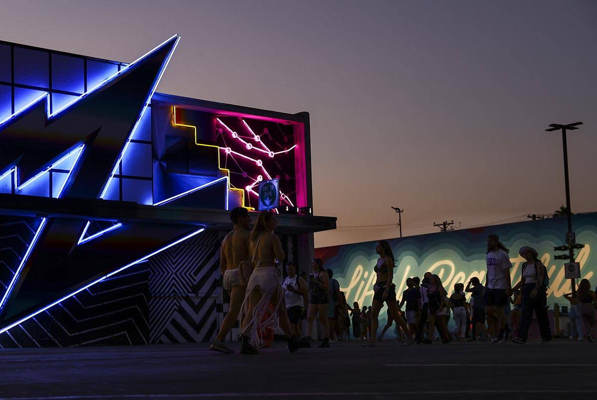 Attendees walk the festival grounds during the final day of the Life is Beautiful festival in d ...