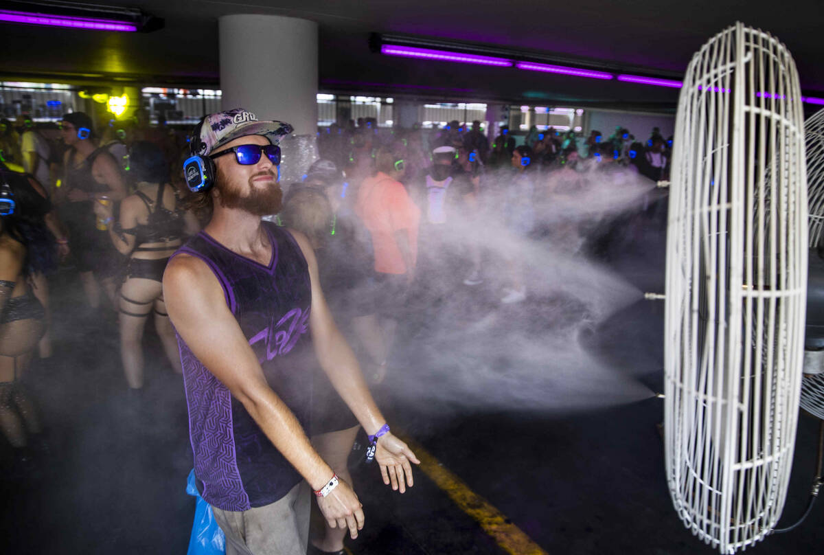 Sky Cook of Denver cools off within a silent disco in a parking lot garage off of South 7th Str ...
