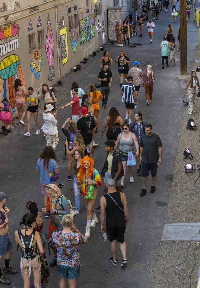 People walk along an alley off of Fremont Street painted with new art during day one of Life is ...