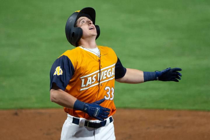 Aviators infielder Frank Schwindel (33) runs through home base after hitting a home run during ...
