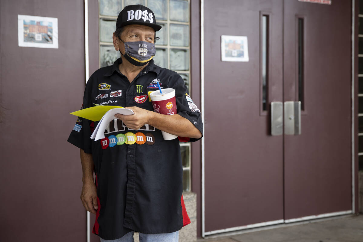 David Pruitt waits to receive a $100 gift card after getting the COVID-19 vaccine during a pop- ...