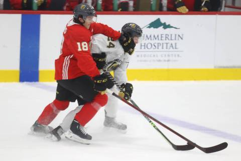 Vegas Golden Knights' Peyton Krebs (18) and Zach Dean (24) fight for the puck during rookie cam ...
