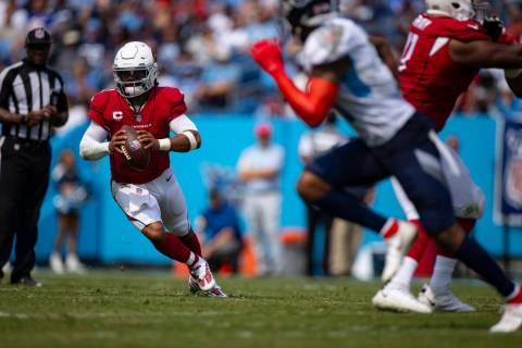 Arizona Cardinals quarterback Kyler Murray (1) runs with the ball against the Tennessee Titans ...