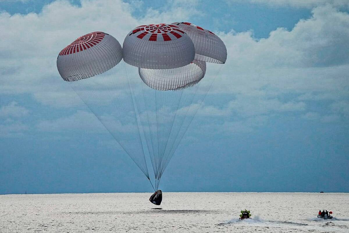 A capsule carrying four people parachutes into the Atlantic Ocean off the Florida coast, Saturd ...