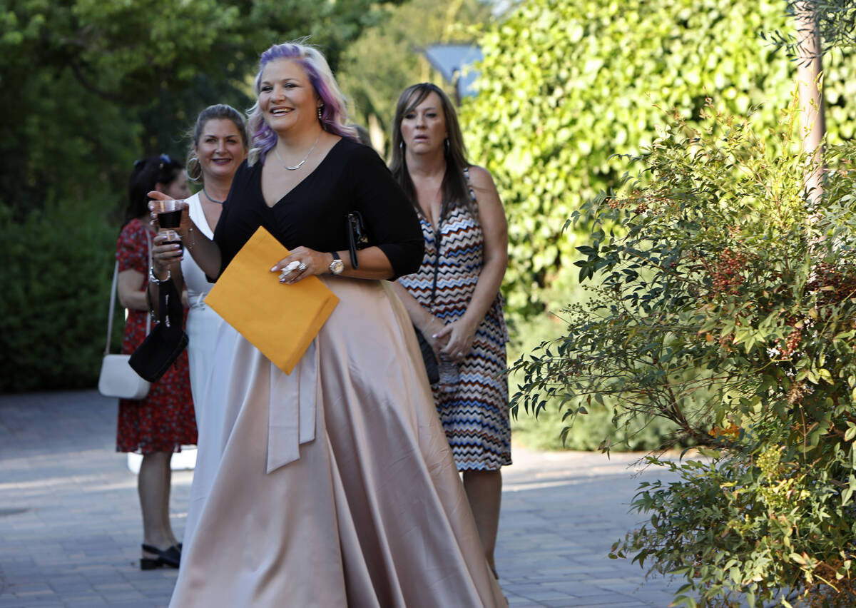 Kristin Bell-Peistrup, center, greets guests during a celebration of life marking the one-year ...