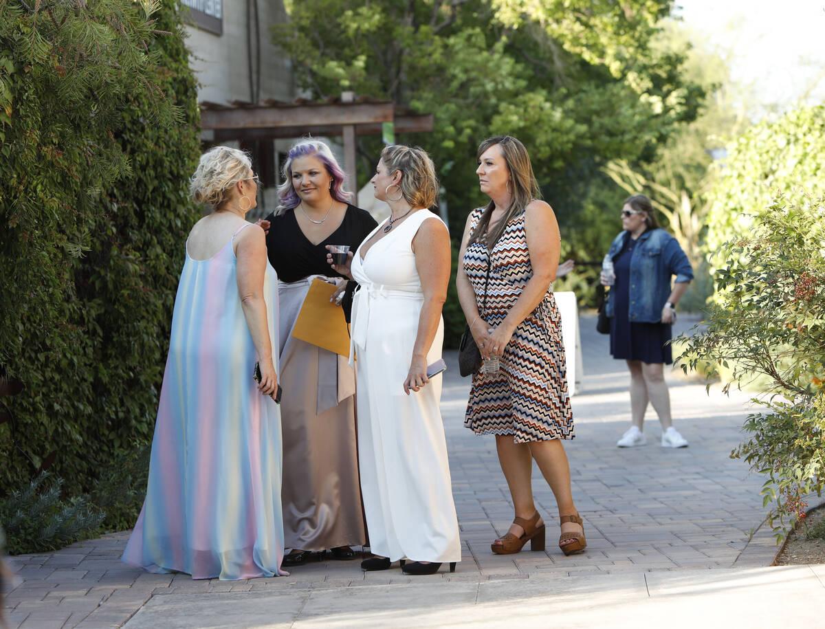 Kristin Bell-Peistrup, second from left, talks with Erika Watson, from left, Billie Burnett, bo ...