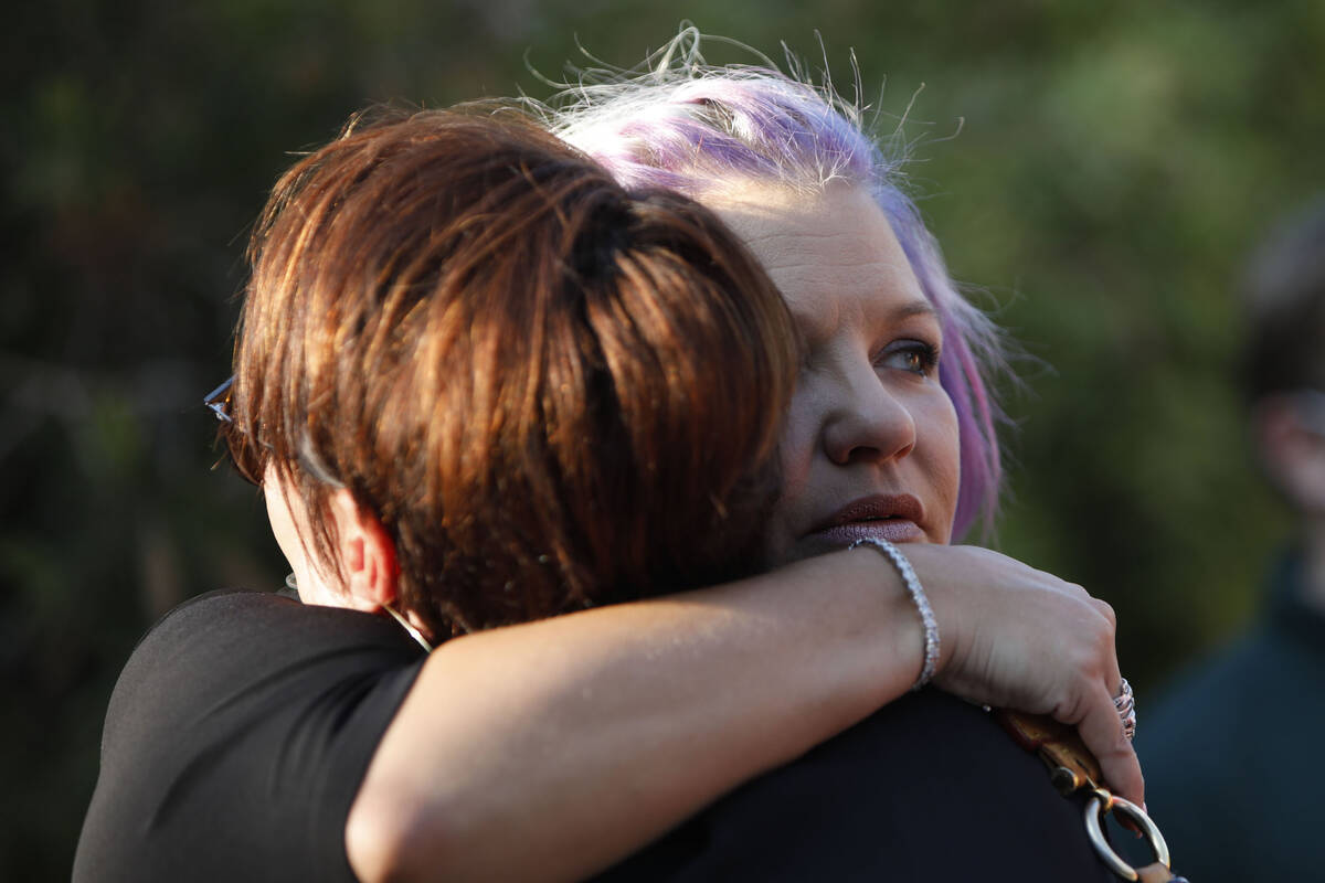 Kristin Bell-Peistrup, face to camera, hugs Kelly Dunagan of Las Vegas during a celebration of ...