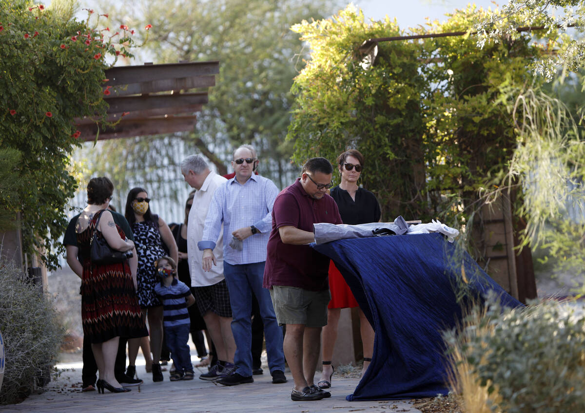 Guests arrive to attend a celebration of life marking the one-year anniversary of Greg Peistrup ...