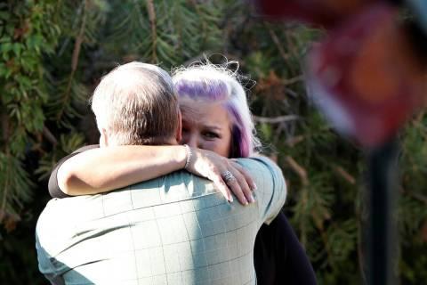 Kristin Bell-Peistrup, face to camera, hugs Mark Jennings of Las Vegas during a celebration of ...